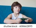 little blond boy playing phone... | Shutterstock . vector #608662895