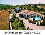 villa in the mountains.... | Shutterstock . vector #608674121