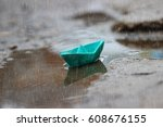 blue boat  rain and a puddle....   Shutterstock . vector #608676155