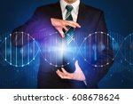 businessman with dna concept in ... | Shutterstock . vector #608678624