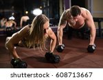 gym man and woman push up...   Shutterstock . vector #608713667
