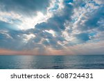 Sunrays Through The Clouds At...