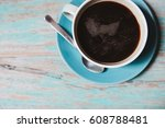 cup of black american coffee... | Shutterstock . vector #608788481