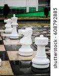 chessmen on the street under in ... | Shutterstock . vector #608792885