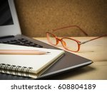 pencil and notebook on laptop... | Shutterstock . vector #608804189