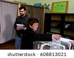 a woman votes in a polling... | Shutterstock . vector #608813021
