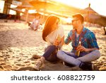 happy young couple drinking... | Shutterstock . vector #608822759