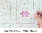 Small photo of hand put missing jigsaw puzzle , solution concept ,key for success