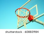 A Basketball Ring Over A Blue...