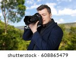 photographer with photo camera...   Shutterstock . vector #608865479