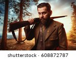 hunter in vintage hunting... | Shutterstock . vector #608872787