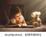 little child girl is reading a... | Shutterstock . vector #608948441