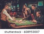 upper class friends gambling in ... | Shutterstock . vector #608953007