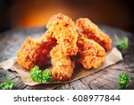 fried chicken wings on wooden... | Shutterstock . vector #608977844
