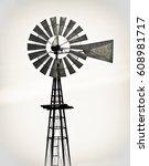 vintage metal windmill against... | Shutterstock . vector #608981717