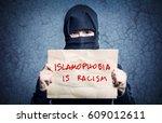 muslim girl in black hijab... | Shutterstock . vector #609012611