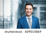 smiling businessman in front of ... | Shutterstock . vector #609015869