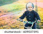child on a bike  in the spring... | Shutterstock . vector #609037391