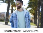 handsome bearded guy in trendy... | Shutterstock . vector #609043691