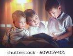 three kids using tablet pc in... | Shutterstock . vector #609059405