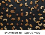 variety of mixed nuts   almond  ... | Shutterstock . vector #609067409