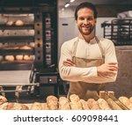 handsome supermarket worker is... | Shutterstock . vector #609098441