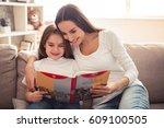 charming little girl and her... | Shutterstock . vector #609100505