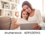 charming little girl and her... | Shutterstock . vector #609100541