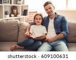 charming little girl and her... | Shutterstock . vector #609100631