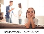 sad little girl is looking at... | Shutterstock . vector #609100724