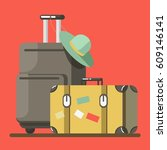 suitcase on wheels with hat on... | Shutterstock .eps vector #609146141