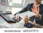businessman refusing money in... | Shutterstock . vector #609147971