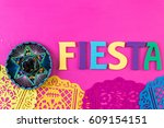 word fiesta on a bright painted ... | Shutterstock . vector #609154151