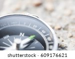 compass with rock background.... | Shutterstock . vector #609176621