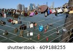Small photo of BROOKLYN, NEW YORK - JULY 19, 2016: Love locks at the Brooklyn Bridge Park in Brooklyn, New York. Ritual of affixing padlocks, as symbol of love, to bridge is spread in Europe from 2000s