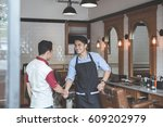 handshake at barbershop. barber ... | Shutterstock . vector #609202979