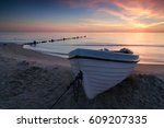 coastal sunrise  fishing boat...   Shutterstock . vector #609207335