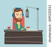 caucasian male radio dj in... | Shutterstock .eps vector #609220511