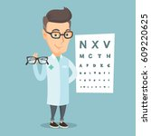 caucasian ophthalmologist... | Shutterstock .eps vector #609220625