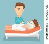 cosmetologist applying cosmetic ... | Shutterstock .eps vector #609220739