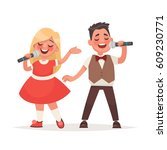 boy and a girl sing a song into ... | Shutterstock .eps vector #609230771