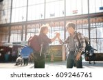 two friends  meeting at the... | Shutterstock . vector #609246761
