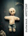 voodoo doll on a wooden... | Shutterstock . vector #609272369