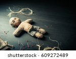 voodoo doll on a wooden... | Shutterstock . vector #609272489