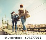 two young girlfriends traveling ... | Shutterstock . vector #609277091