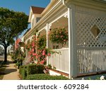 This is a shot of a nice home along a street of nice old houses. - stock photo