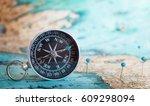 compass on map.  | Shutterstock . vector #609298094