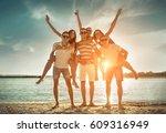 friends fun on the beach under... | Shutterstock . vector #609316949