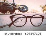 broken glasses with motorcycle... | Shutterstock . vector #609347105