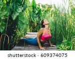 young woman practicing yoga... | Shutterstock . vector #609374075
